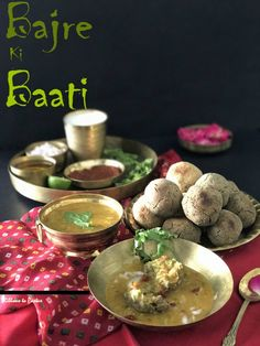 Bajre ki Baati is a bread from Rajasthan which is a hard unleavened bread made with pearl millet . These are round balls of dough , baked to perfection and soaked in ghee. Ideally served with daal . Indian Snacks, Indian Breads, Cooking With Ghee, Pearl Millet, Rajasthani Food, Rice Bread, Radish Greens, Desi Food, Chapati