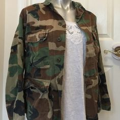 "'Bad Girl Femininity'  Well-loved camo jacket - looks so cute paired with a feminine cami underneath. The size tag is difficult to read but it fits like a misses large. Approx 26 1/2"" in length from shoulder to hem on back. *listing is for jacket only* Jackets & Coats"