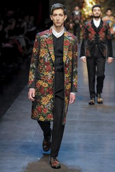 "FALL 2013 MENSWEAR Dolce & Gabbana /  Domenico Dolce and Stefano Gabbana herded the menfolk from a couple of Sicilian villages onto their catwalk for Spring, and the result was so curiously profound that it's no wonder they did the same thing for their Fall show, street-casting 82 men and boys. It was even more appropriate given that their theme was ""devotion."" You could look at the entire Dolce & Gabbana saga as one long love story."