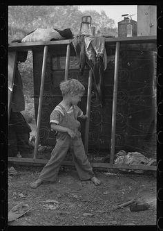 "Dorothea Lange: ""Son of destitute migrant, American River camp, near Sacramento, Calif. The boy has dysentery."""