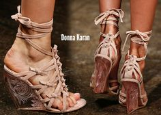 Donna Karan Spring 2013 Fashion Week wedges. They feature a carved lucite wedge, suede, leather, snakeskin with lots of knotted detailing and leather ankle-wraps.