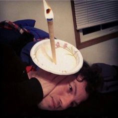 Why does the internet have a picture of Josh Dun using an ear candle?
