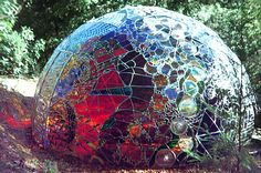 """""""Completed in 1974, Wholeo Dome is a 14-foot-in-diameter, 7-foot-tall geodesic dome covered with curved, stained glass panels.  In 2004, after having been kept in storage for more than twenty years, Wholeo Dome is installed at The Farm School in Summertown, TN, USA."""""""