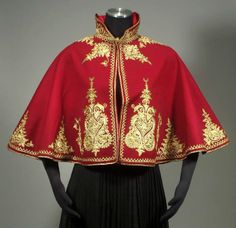 Very elaborate Ottoman style evening cape showing applied gold braid/threadwork on red wool ground