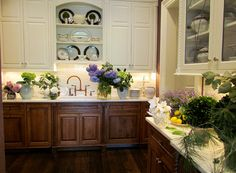 Flower arranging room/butler's pantry - dark wood base cabinets, cream upper cabinets, some with glass doors, open shelves above sink - wood floor - cream counters -- Gardiner & Larson Homes