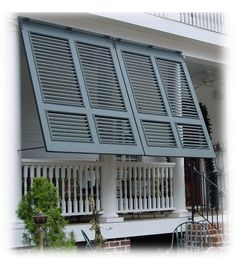 bahama shutters for the porch WITH a railing. Great for privacy and still feel breeze