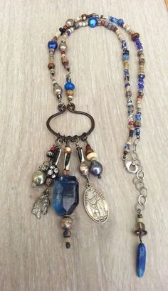 Prayer Beads.  I like the variety beads on the necklace and the dangles on the pendant in the center