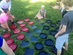 Paint bucket lids and stick on floor tiles spray painted=giant checkers!!