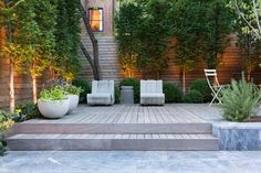 Stylish, low maintenance and family friendly, this bi-level Brooklyn backyard by Brook Landscape features a marble patio, wood deck and layered plantings. Garden Landscape Design, Garden Landscaping, Modern Landscaping, Landscaping Design, Brooklyn Backyard, Pergola, Porche, Outdoor Living, Indoor Outdoor