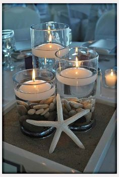 Candles and starfish centerpiece. Beach Themed weddings. Catering by Fosters Premium Catering for millennium weddings, rehearsal dinners and receptions. York, Maine. Http://www.fosterspremium.com