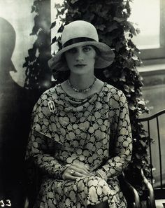 Lee Miller modeling Marie-Christiane hat and dress and jewelry by Black, Starr and Frost.  Edward Steichen.