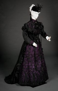 Mourning day dress, c. 1897-99. FIDM Museum. There is some purple color in the gown, indicating that this lady is in a later stage of mourning, i.e., past the first year.