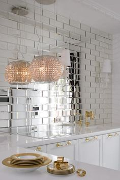 Mirrored subway tiles - this would be pretty in a bathroom