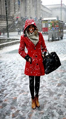 Red wool coat on a snowy city day.