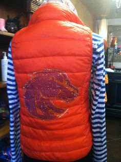 Large Crystal Bronco head on the back of VillaStyle  light down vest.