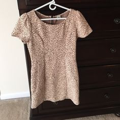 NWOT Small Urban Outfitters Tab and Cream Dress Beautiful size small brown and cream vintage vibe urban outfitters dress for sale. Never worn without tags. Brand on tag says I.ner but bought at store. No damage, stain, rips, or tears. Comes up to me mid thigh (I'm 5'6) for reference. Ready for a good home. Please feel free to leave comments or questions. All offers will be considered when placed with offer button. Urban Outfitters Dresses Midi