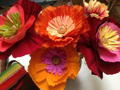 I love to make Mexican crepe paper flowers using a very stiff high quality crepe paper.