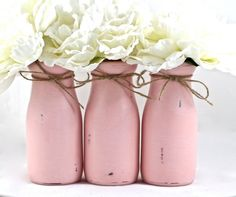Use Starbucks frappe glass bottles. Fill with flowers