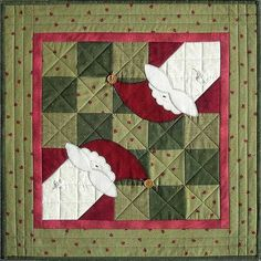 """Christmas Corners"" table topper, pattern by Terry Morberg"