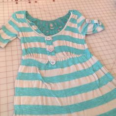Turquoise and Gray shirt It's a beautiful turquoise and gray stripped shirt with beautiful accents on the back Rue21 Tops Tees - Short Sleeve