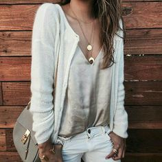 cream cardigan with silk camisole and khakis.