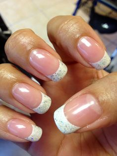 Shellac french manicure with glitter on the tips.