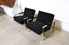 Pair of Mirror Polished Brass Lounge Chairs by Milo Baughman | From a unique collection of antique and modern lounge chairs at https://www.1stdibs.com/furniture/seating/lounge-chairs/