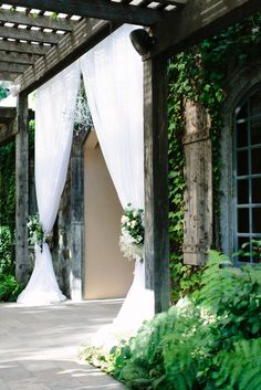 White-fabric wedding arch