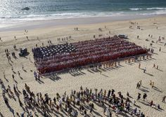 Over 3,000 people in Australia replicate the American flag on the one year anniversary of 9/11.