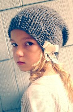 Knit Beanie. Slouch Hat. Slouchy Knitted Beanie. Chunky Cap with Lace Bow Button. $25.00, via Etsy.