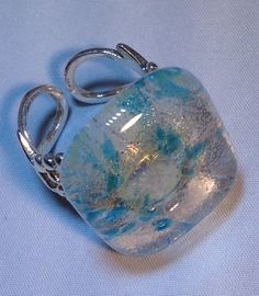 Adjustable Clear Iridescent Blue Specks Ring with silver plated filigree band http://www.glassbyhelen.com