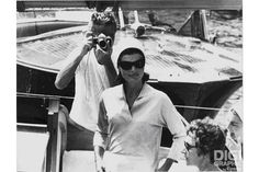 Jackie Kennedy and photographer, 1962 (photo by Benno Graziani)