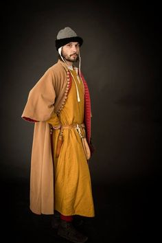 1st half of 14 th century, silk tunic, woolen surcote with red linen, woolen cap trimmed with fur