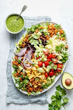 The best chicken taco salad loaded with taco seasoned ground chicken, fresh produce, savory cheese and a wonderful cilantro vinaigrette. Taco Salad Recipes, Summer Salad Recipes, Summer Salads, Healthy Recipes, Healthy Meals, Yummy Recipes, Bariatric Recipes, Snacks Recipes, Summer Food
