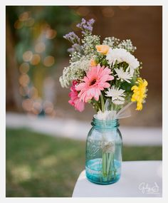 colorful spring flower bouquet in blue mason jar, Gaby J Photography