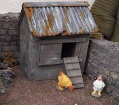 I wanted my chicken coop to have an old corrugated tin sheet roof so I painted some corrugated cardboard in different shades of grey acrylic paint roughed up the edges a bit and glued the pieces to the wooden roof. I then areas with scenic rust