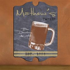 "Our Personalized Man Cave Pub Signs are ideal for his office, man cave, den, home bar, garage or basement. These unique, personalized signs add a classic look to the walls of his special nook or any other decor. Ready to hang, the signs are personalized with his name up to 15 characters at the top of the sign, up to 30 characters open text of your choice below name (to replace the black text) and established year. Sign measures 10 3/4"" x 15 1/2"" x 1/4""."