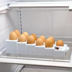 You won't waste fridge space with a half-empty carton. Eggstra Space tray adjusts.