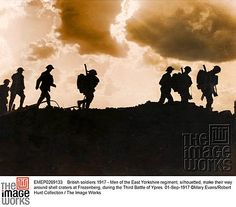 British soldiers 1917 - Men of the East Yorkshire regiment, silhouetted, make their way around shell craters at Frezenberg, during the Third Battle of Ypres 01-Sep-1917 EMEP0269133