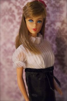 Twist 'n Turn Barbie, I had her with black hair and I had this dress, but unfortunately mice got to it :(