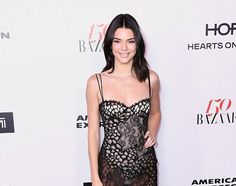 KENDALL JENNER STUNS IN A SEE-THROUGH GOWN AT HARPER'S BAZAAR EVENT