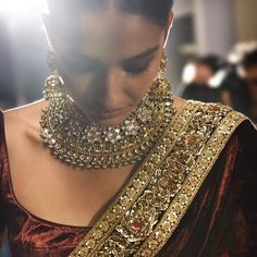 Indian Dark-Red Saree & Gold Jewelry Designed by Sabyasachi Indian Attire, Indian Wear, Indian Style, Indian Dresses, Indian Outfits, Ethnic Outfits, Velvet Saree, Henna, Desi Clothes