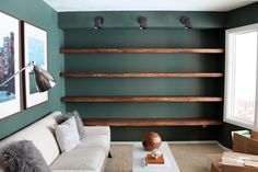 10 Awesome Room with DIY Shelves: 10 Awesome Room With DIY Shelves With Wooden Shelves And Dark Green Walls And White Sofa And Wooden Table Design