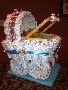 What a FUN, Unique baby shower gift! Each Diaper Carriage includes about 50 diapers, a stuffed animal, Johnson & Johnson travel pack lotion,