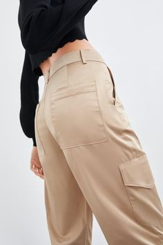 High-waist trousers in slightly stretchy fabric with false pockets and zip fly and metal hook fastening. Cargo Pants, Khaki Pants, Next Store, Wide Leg Trousers, Zara Women, Hair Band, High Waisted Skirt, Leather Pants, Pants For Women