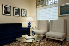 small space waiting room - love the color scheme and black and white photos