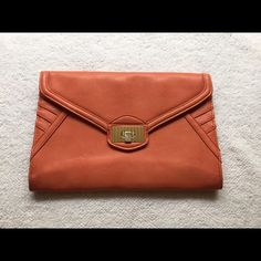 Danielle Nicole clutch Adorable salmon colored clutch for a night on the town! Pre used but in excellent condition. Danielle Nicole Bags Clutches & Wristlets