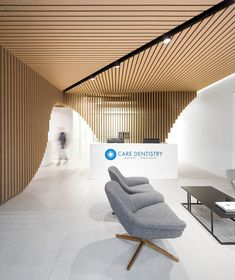 Image 1 of 23 from gallery of Care Implant Dentistry / Pedra Silva Architects. Photograph by Fernando Guerra Clinic Interior Design, Clinic Design, Healthcare Design, Medical Design, Office Space Design, Dental Office Design, Corporate Interiors, Office Interiors, Hospital Design