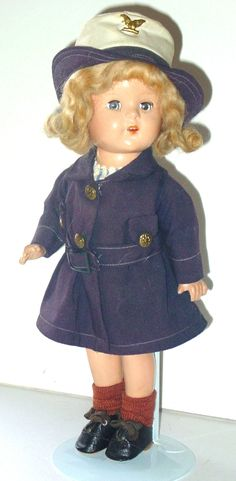 """13"""" WWII Wave   In the early years of Vogue Dolls, the company used composition dolls made by other companies. This doll was made with the same mold as the Alexander's Princess Elizabeth. Vogue's claim to fame was clothes and the dolls were incidental before Ginny. The company dressed many dolls of this and the Alexander Princess Elizabeth type. They aren't marked so it's the clothes that identify them."""