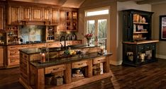 What do you think of this rustic kitchen design - too much or just right? If you could change one thing, what would it be? Kraftmaid Kitchen Cabinets, Antique Kitchen Cabinets, Kitchen Cabinet Styles, Rustic Cabinets, Bathroom Cabinets, Corner Cabinets, Kitchen Hardware, Wooden Cabinets, Home Fireplace